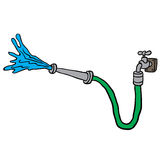 Faucet with garden hose Royalty Free Stock Photo