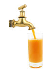 Faucet and glass of juice Royalty Free Stock Photos