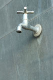Faucet on a gray background at the toilet Royalty Free Stock Photography