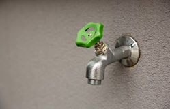 Faucet with green valve Stock Image