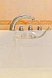 Faucet handles in the bathroom shower Royalty Free Stock Photos