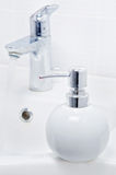 Faucet and liquid soap container Stock Images