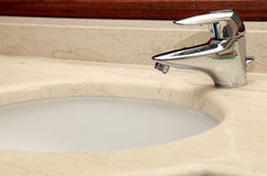 Faucet and marble sink Stock Photography