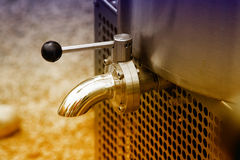 Faucet on milk cooling tank. Close up of faucet on milk cooling tank in dairy plant royalty free stock photos