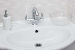 Faucet in a modern bathroom Royalty Free Stock Images