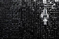 Faucet. Modern design home bathroom Faucet on black tile Stock Images