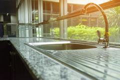 Faucet   in modern house with sunshine from garden. 1 Royalty Free Stock Photo