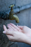 Faucet. And palm,Water scarcity Stock Photography
