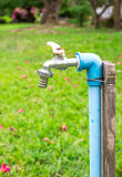 Faucet with In The Park Royalty Free Stock Photos