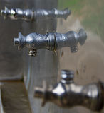 Faucet Press. Faucet cold water tanks pressed on for a drink Royalty Free Stock Image