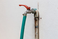 Faucet with rubber tube. On the well Stock Photos