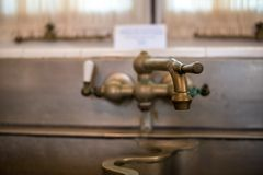 Faucet. Running faucet on the kitchen sink Royalty Free Stock Photos