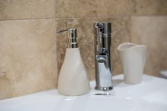 Faucet. Running faucet on the kitchen sink Stock Photography