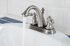 Faucet with Running Water Royalty Free Stock Photography