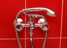 Faucet and shower in bath Stock Image