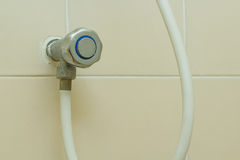 Faucet Shower. Dirty faucet of the shower made from stainless steel in side view Stock Image