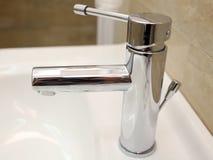 Faucet. A simple faucet in a hotel bathroom Stock Photos