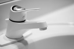 Faucet and sink Stock Photo