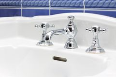 Faucet and sink close-up Royalty Free Stock Image