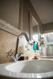 Faucet in sink in empty bathroom. At home Stock Photo