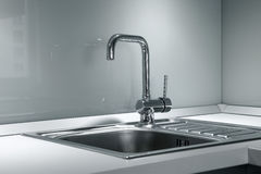 Faucet and sink in the kitchen. One mixer and sink in a modern kitchen Stock Photo