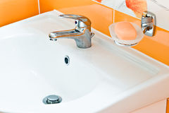 Faucet sink and soap bar Royalty Free Stock Images