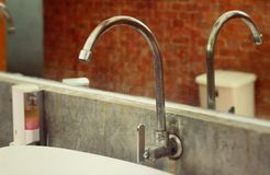 Faucet in toilet Royalty Free Stock Images
