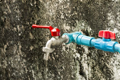 Faucet and valve mounted on the wall royalty free stock image