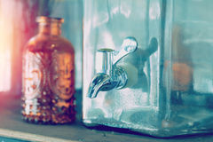 Faucet from vintage glass water cooler. Stock Image