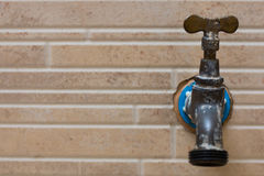 Faucet on the wall. Texture wall with a faucet Royalty Free Stock Images
