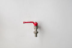 Faucet on the wall. Faucet on the white wall Stock Photography