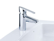 Faucet and wash basin isolated on white  Stock Photos