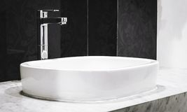 Faucet with wash basin in bathroom Royalty Free Stock Images