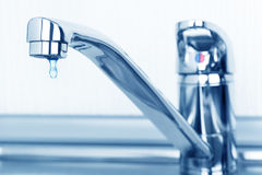 Faucet and water drop royalty free stock images