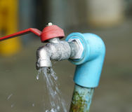 Faucet and water. Faucet water is flowing in Thailand Stock Photo