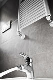 Faucet with water and heater Royalty Free Stock Image