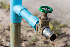 Faucet with Water mains Royalty Free Stock Images