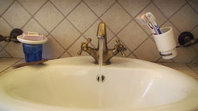 Faucet water tap open close hand stock footage