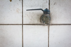 Faucet on white Flagstone. The faucet on white Flagstone Royalty Free Stock Photo