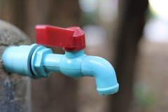 Faucets и рука Стоковая Фотография RF