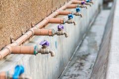 Faucets на стене Стоковая Фотография RF