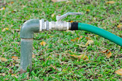 Faucets of lawn care system Stock Images