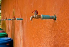 Faucets with old plaster walls orange. Stock Image