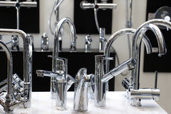 Faucets. Picture of a faucets in a showroom stock photos