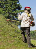 Fauchage de la pelouse de la colline Photos libres de droits