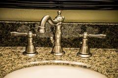 Fauctet del bagno del nichel Fotografia Stock