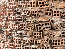 Faulty bricks wall. Front view of wall made of faulty bricks Royalty Free Stock Images