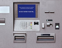 Faulty cash machine. Banking machine with faulty warning sign on screen Stock Photos