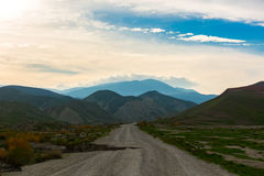Faulty country road. Scenic view of mountain road, Nature landscape Stock Photos
