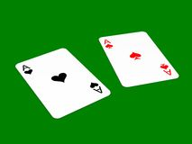 Faulty perception of suit concept. Black ace of hearts and red ace of spades lied on green background Stock Photography